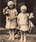 Kitty left and Nellie right as bridesmaids at half sister Lil's wedding in 1926