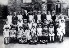 Early school photo of Nellie at East Hoathly School. Nellie is third from the left in the back row.