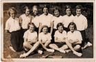 "Nellie with East Hoathly Stoolball team 1937. The last line on the back of the photo reads ""Captain Nellie Cottingham."" Nellie is pictured centre back row."